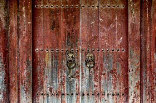 A Rustic Wooden Door with Knockers
