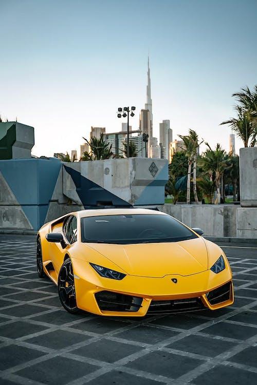 Yellow Lamborghini Aventador Parked Near Gray Concrete Building