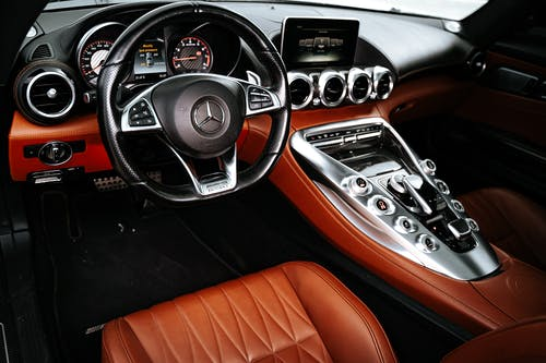 Black and Brown Mercedes Benz Steering Wheel