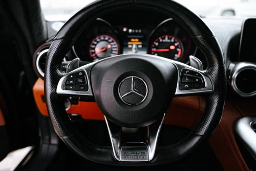 Black and Orange Mercedes Benz Steering Wheel