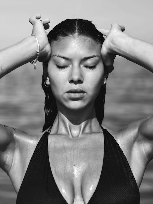 Sensual woman with wet hair in bikini