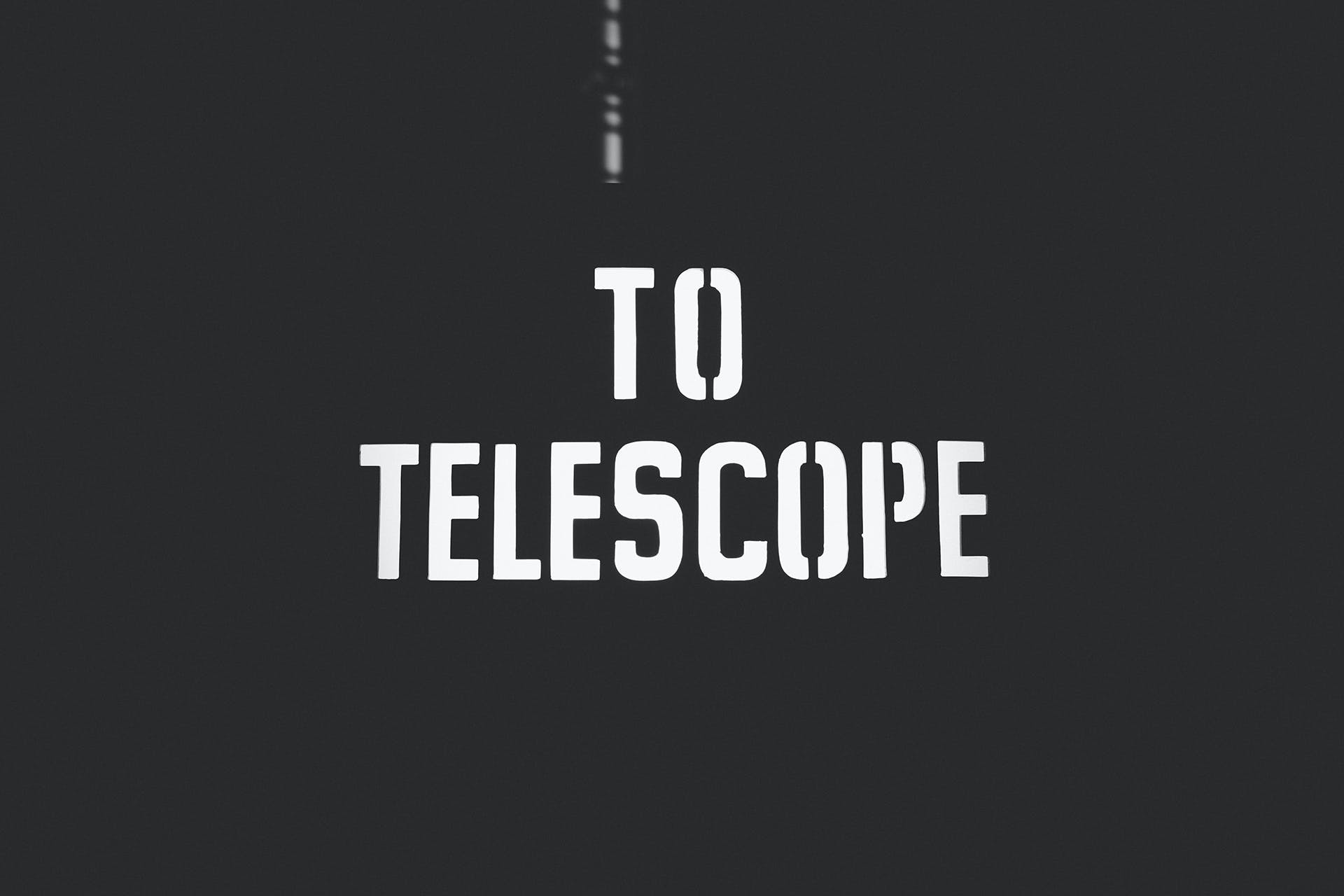 Black Background With to Telescope Text Overlay