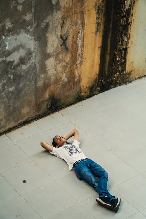 A Man Lying on the Floor