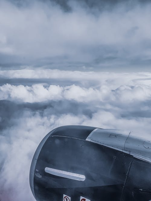 Engine turbine of plane in clouds