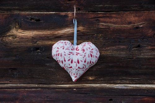 Decorative heart on wooden wall