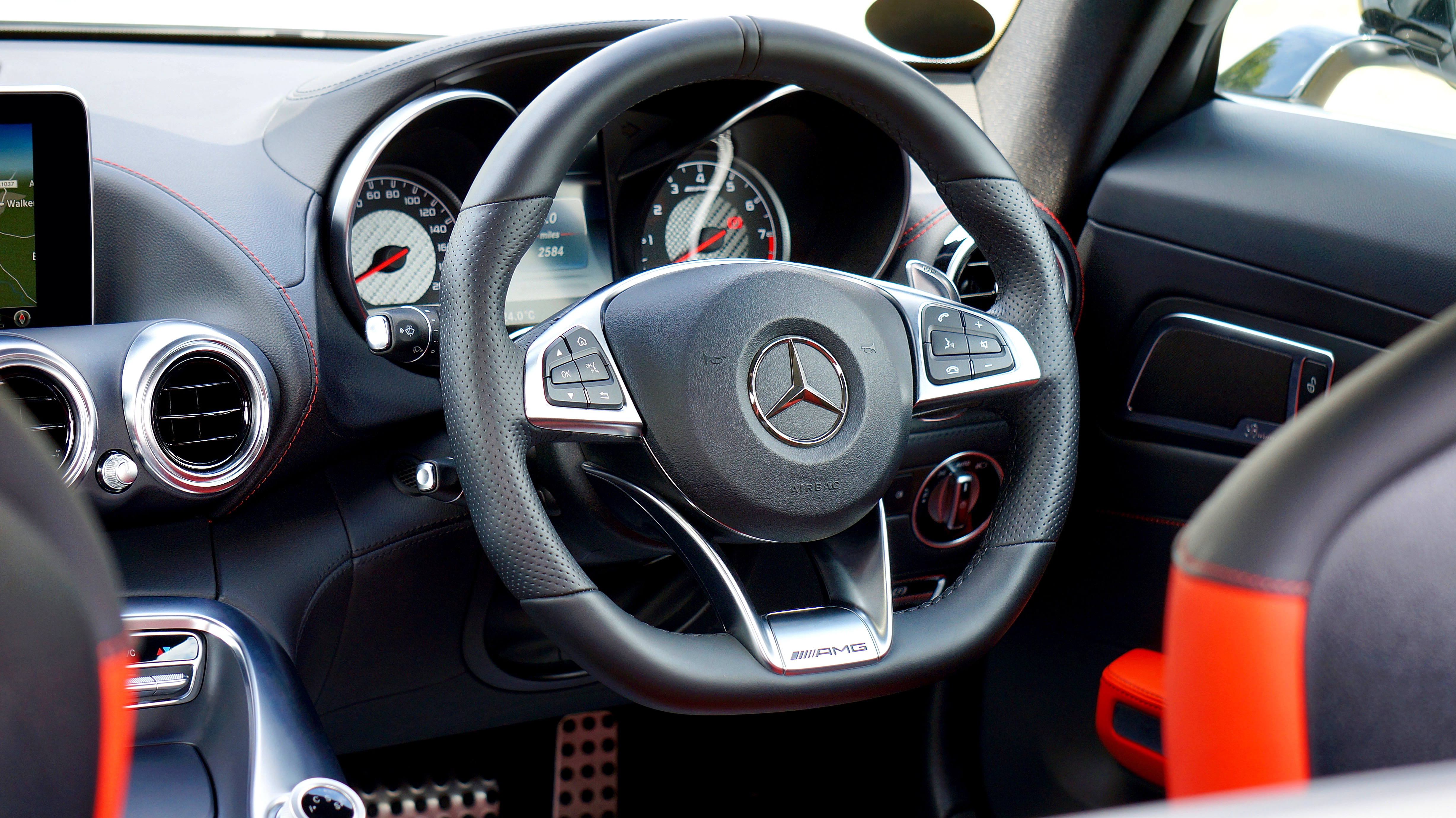 Selective Focus Photography of Mercedes-benz Multi-function Steering Wheel
