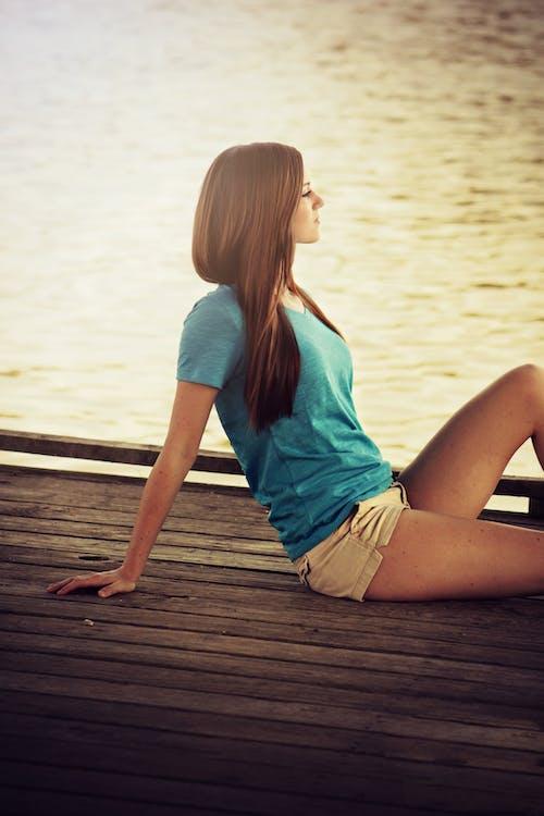 Women's Blue V-neck Shirt on Beige Shorts