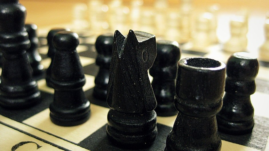 Black Chess Pieces on Chess Board