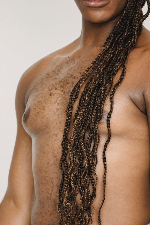 Crop shirtless black man in studio