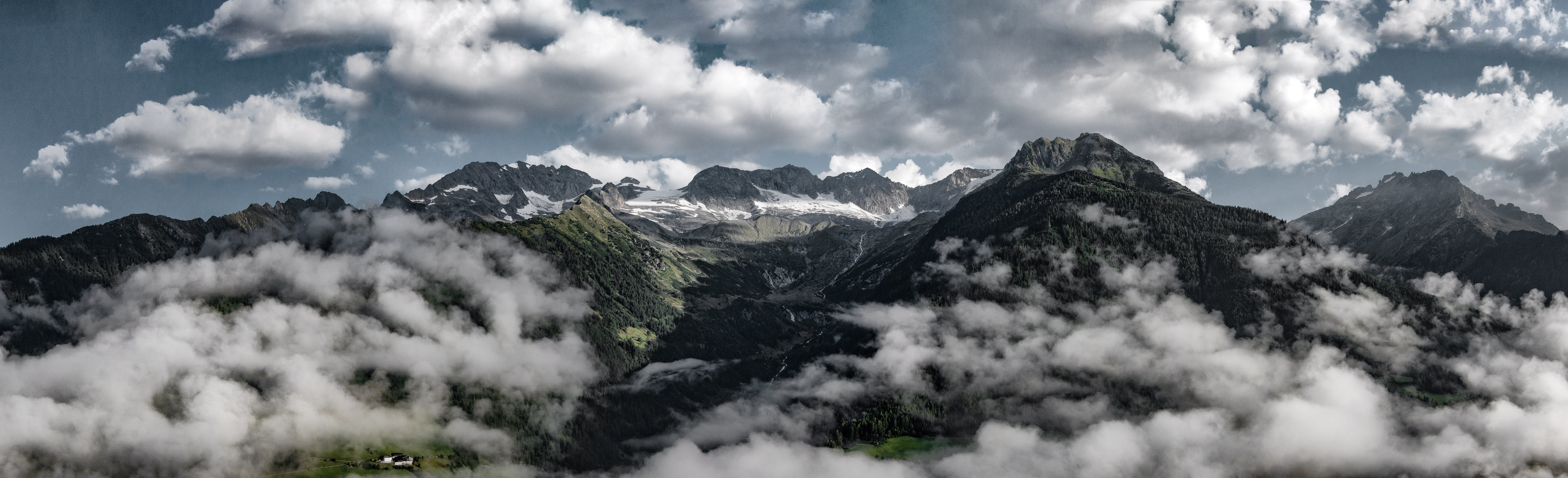 Aerial View of Mountain Covered in Clouds