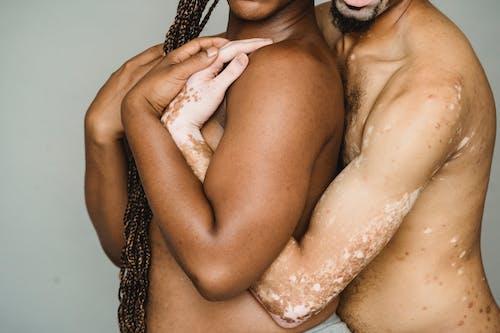 Transgender multiracial men hugging each other