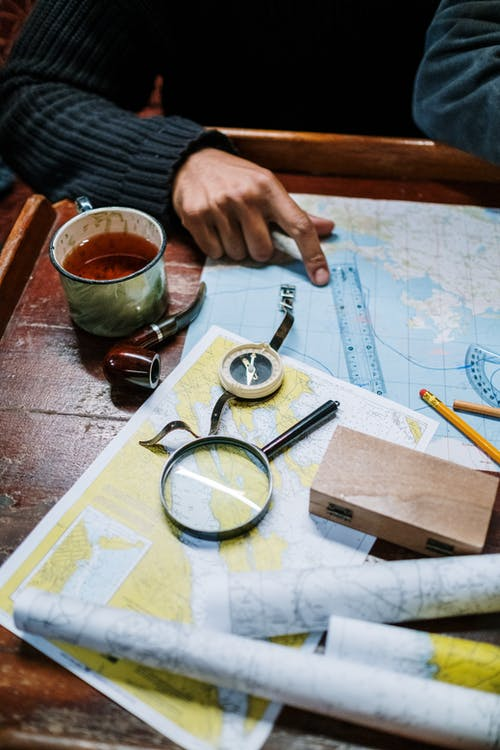 Person Holding Black Magnifying Glass