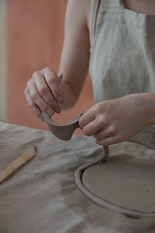 Crop artisan creating clay crockery