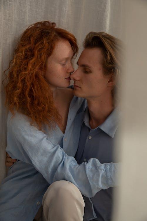 Romantic couple embracing near curtain