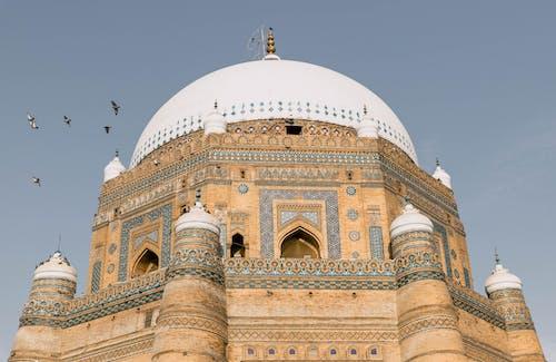 Brown Concrete Dome Building Under Blue Sky