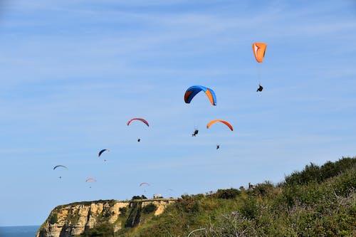 Photos gratuites de dans l'air, euphorie, faire du parapente