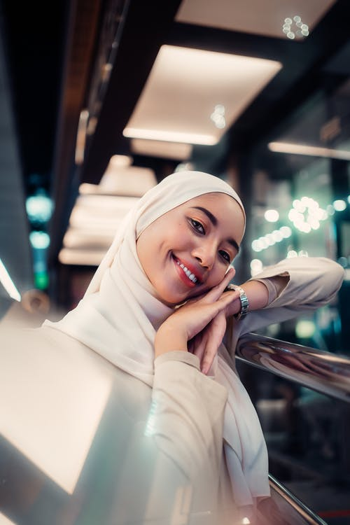 Woman in White Hijab Holding Her Face