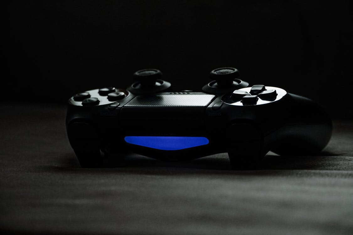 Black and Blue Game Controller