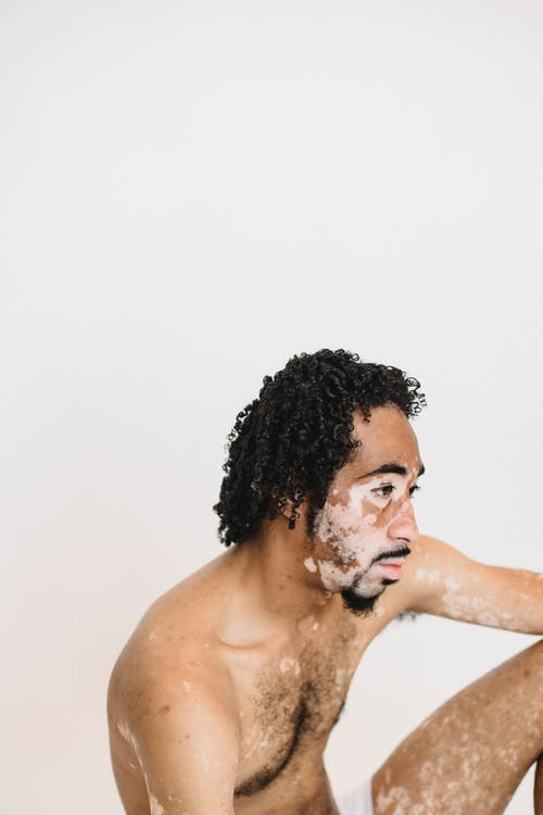 Topless Man With White Powder on His Face
