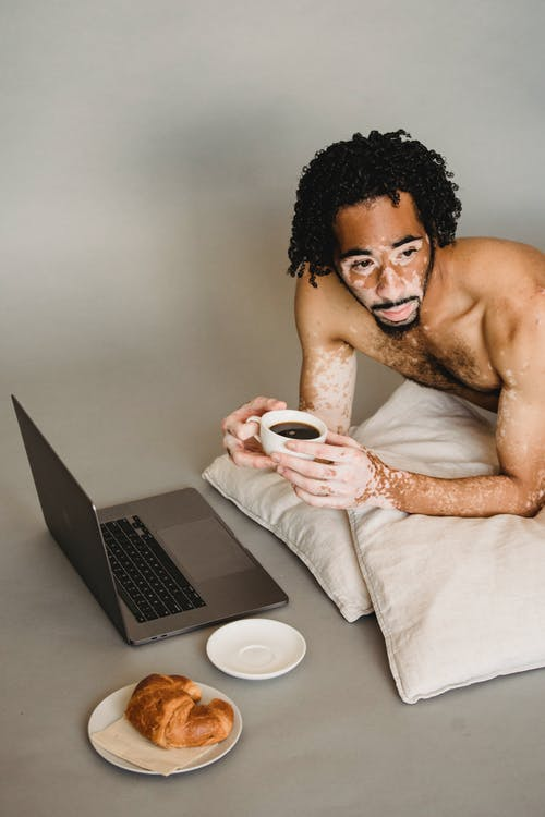 Topless Man Holding White Ceramic Mug