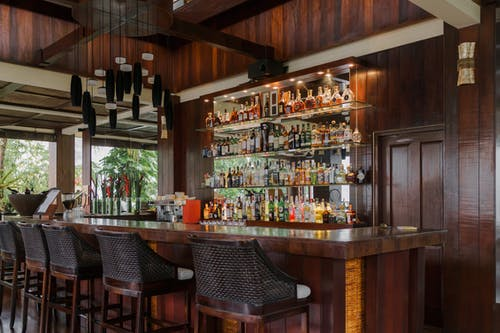 Brown Wooden Bar Counter With Chairs