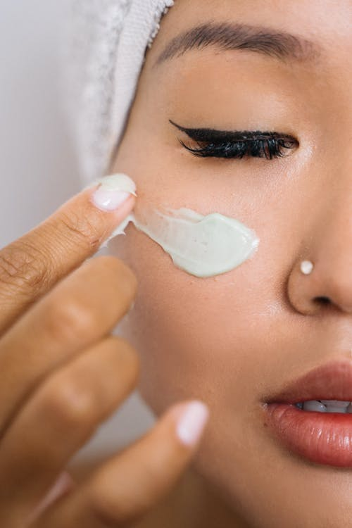 Woman With White Cream on Her Face