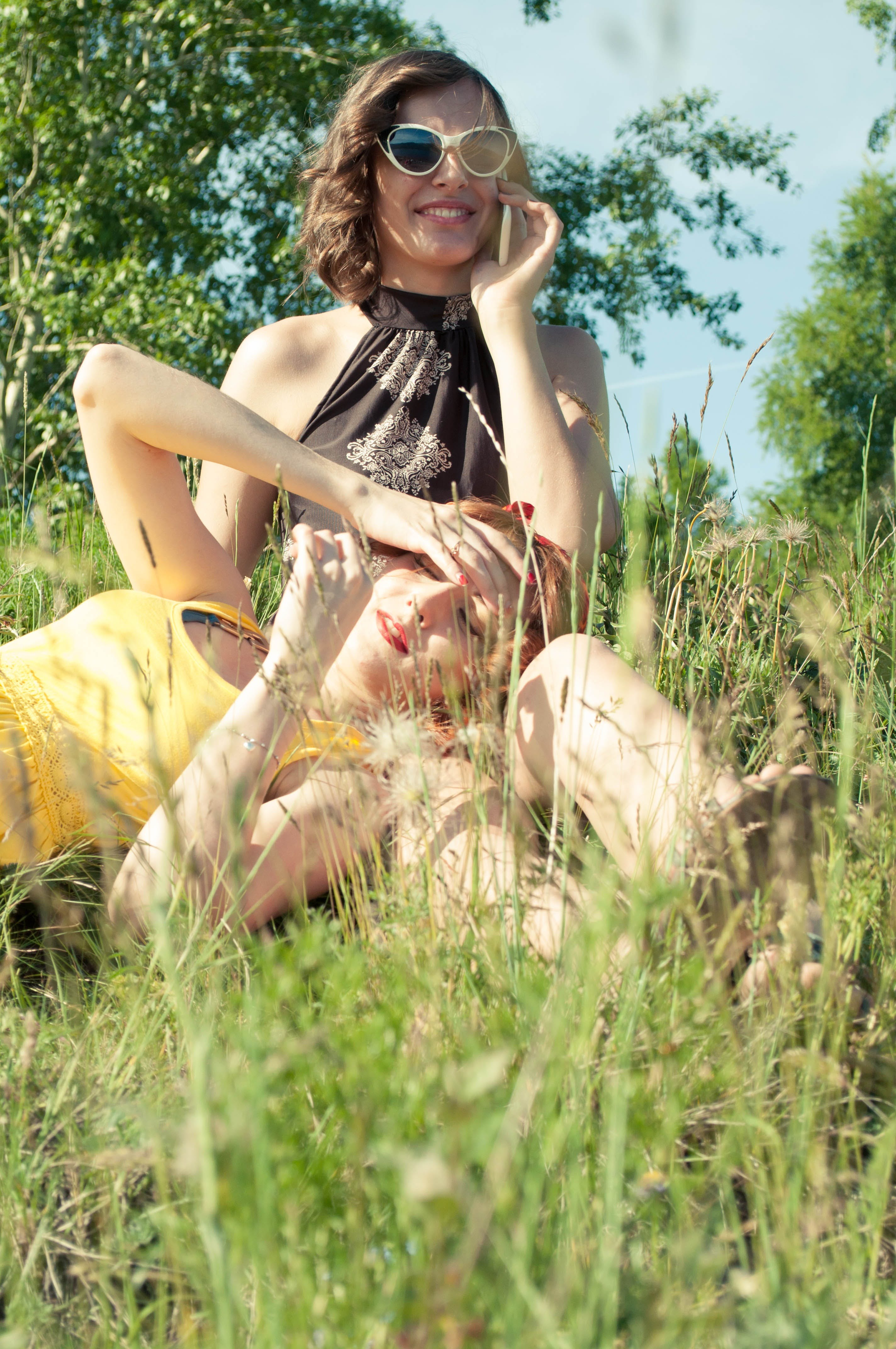 Two Woman on Green Grass during Day Time
