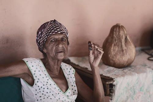 Old black woman smoking cheroot