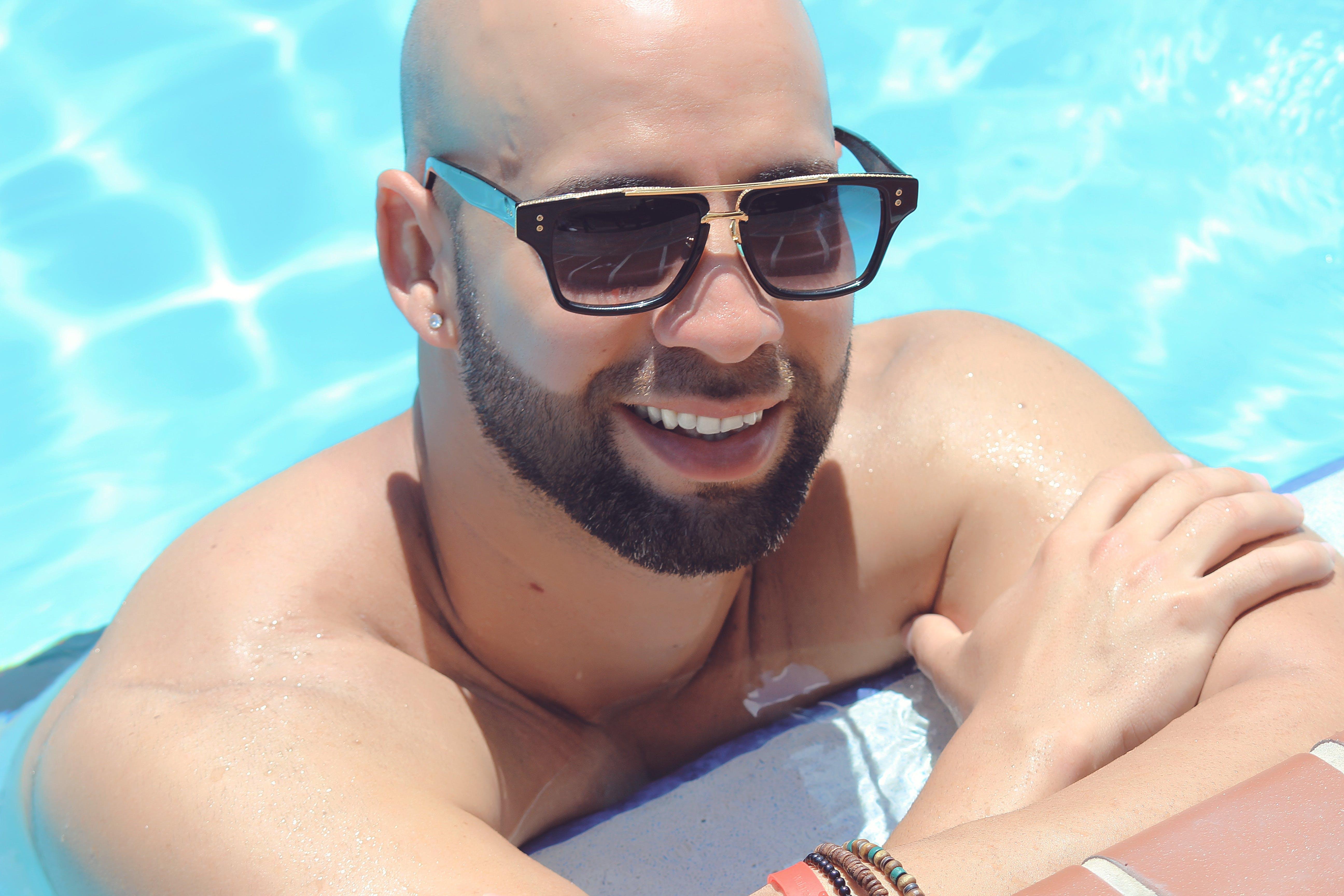 Man Wearing Black Framed Sunglasses