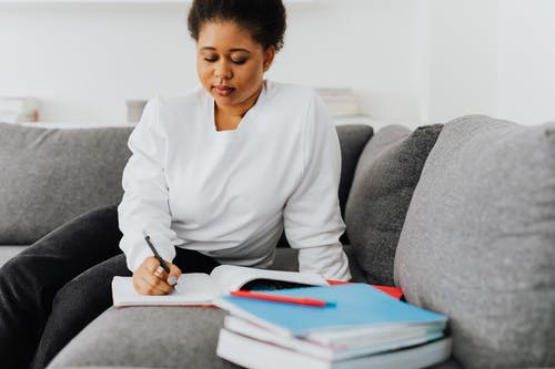 Woman In White Top Writing