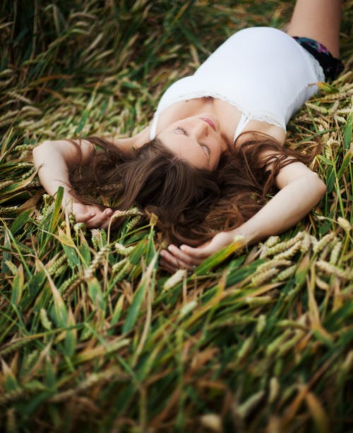 Woman Laying on Wheat Field