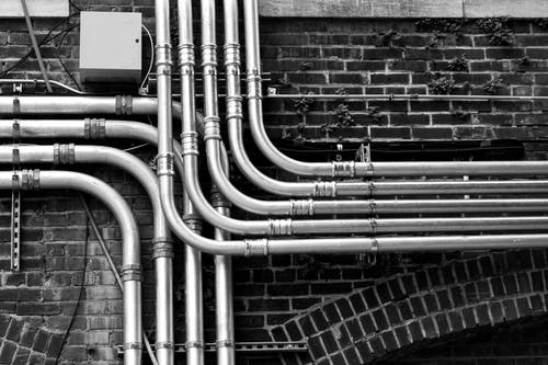 Pipelines Mounted on Wall ]