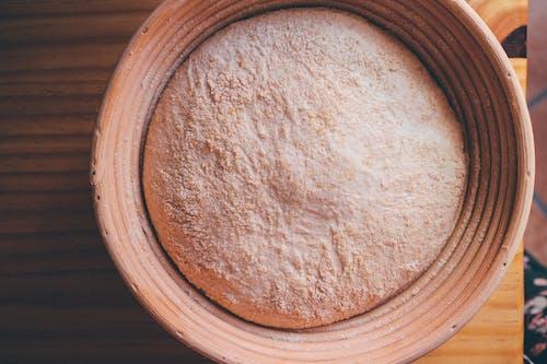 Brown Powder on Brown Wooden Round Plate