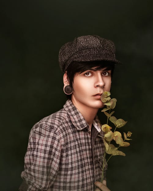 Boy in Black and White Plaid Button Up Shirt Wearing Black Hat