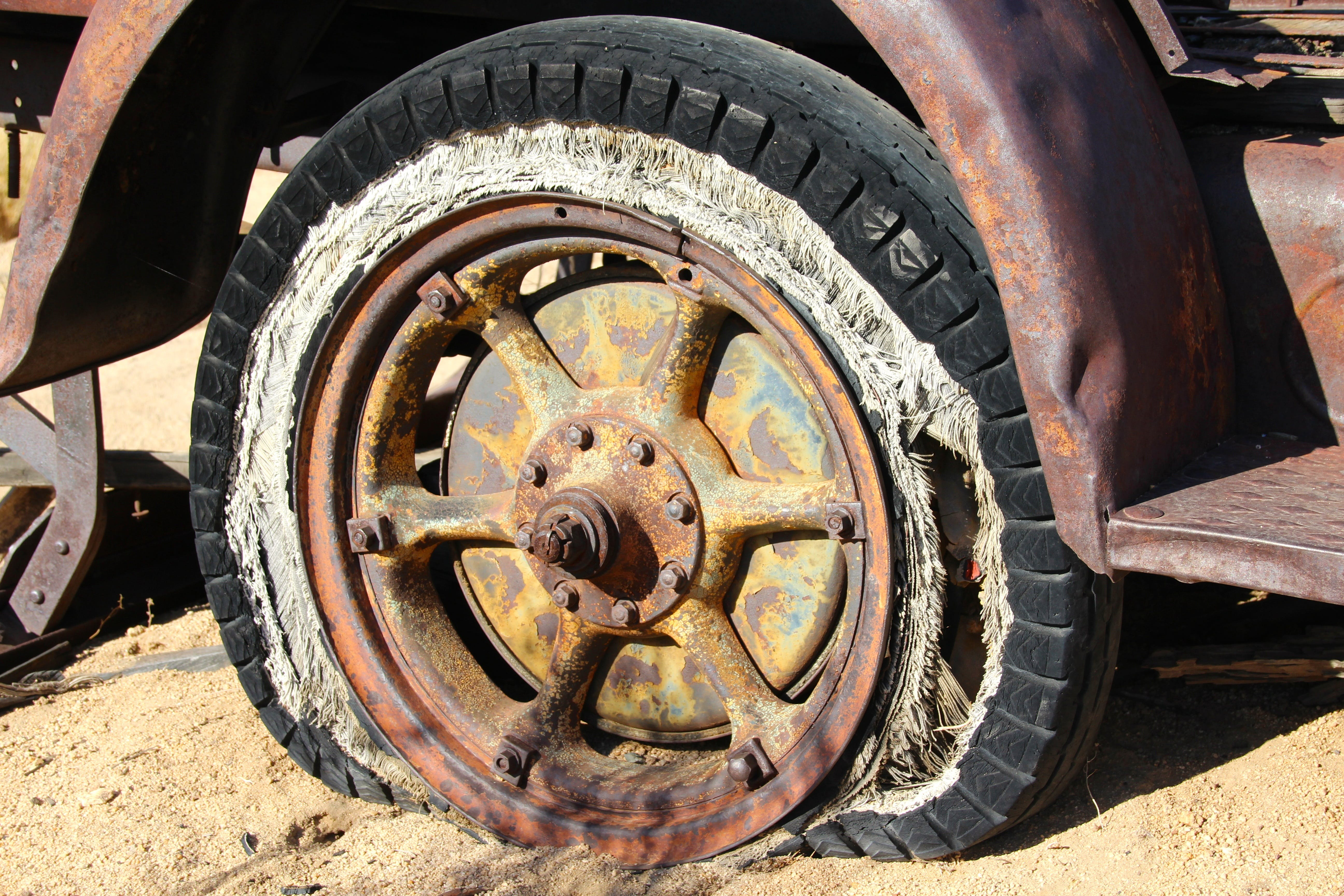 Brown Spoke Car Wheel in Brown Sand during Daytime