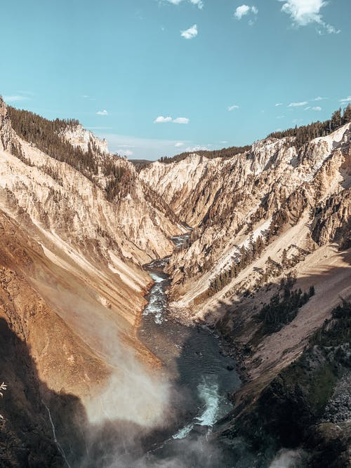 Breathtaking scenery of wild river flowing through rough rocky mountains in Grand Canyon of Yellowstone National Park