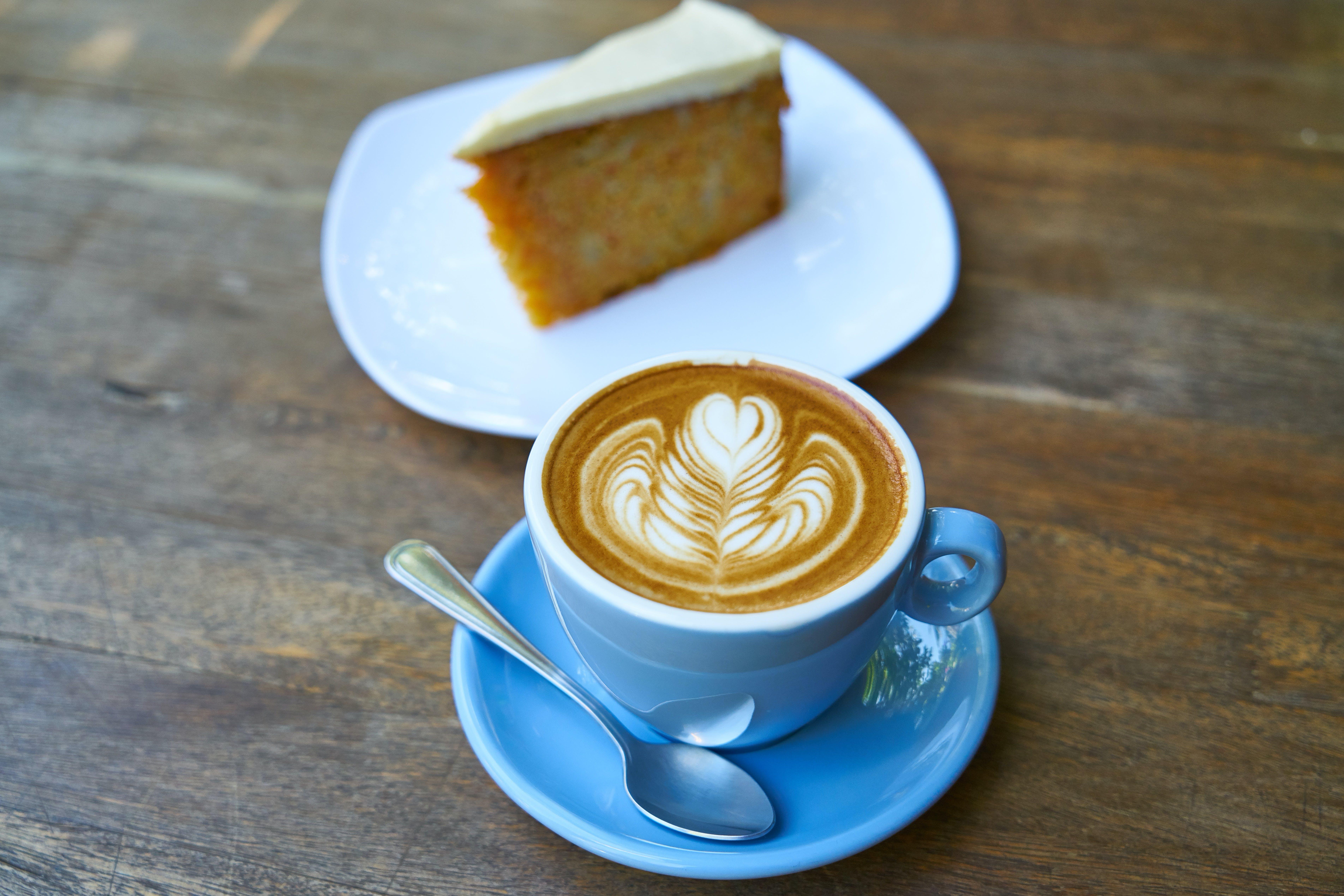 Cappuccino Beside Sliced Cake
