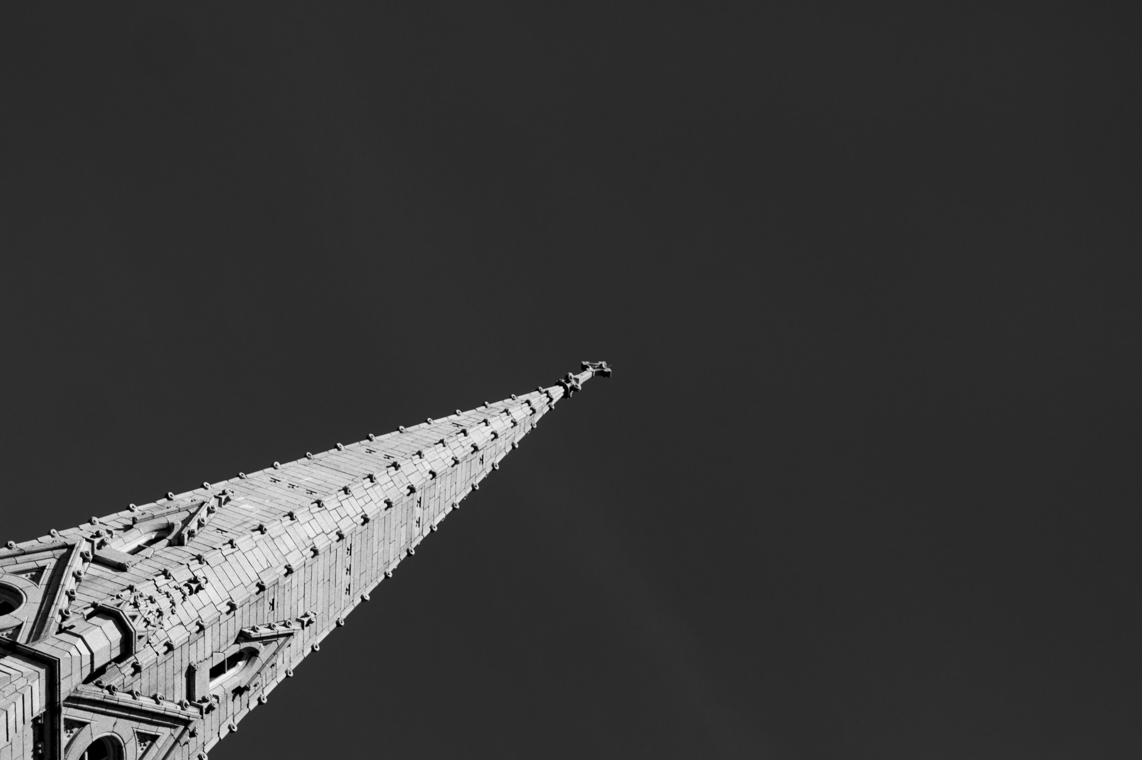Grayscale Photography of Concrete Tower