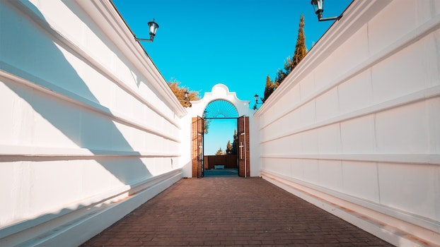 Free stock photo of sky, lamp, alley, gate