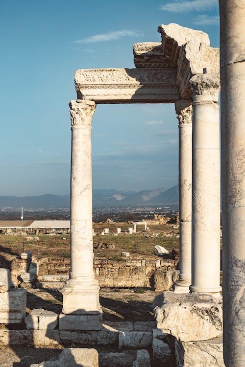 White Concrete Pillar Under Blue Sky