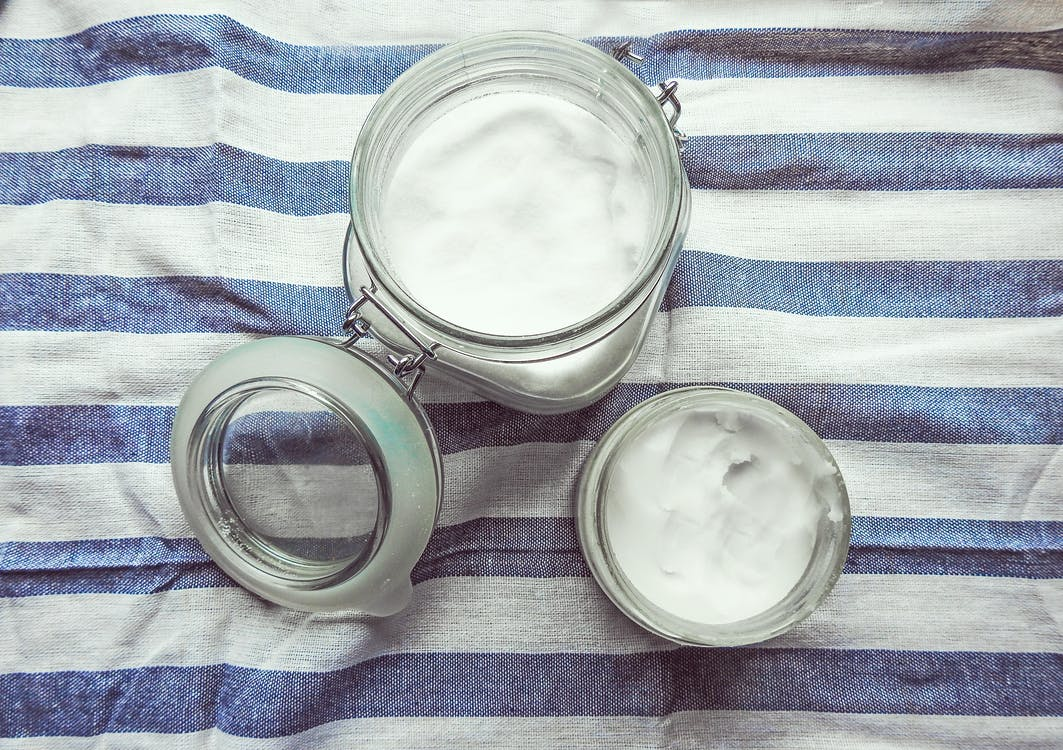 coconut oil contained in a glass