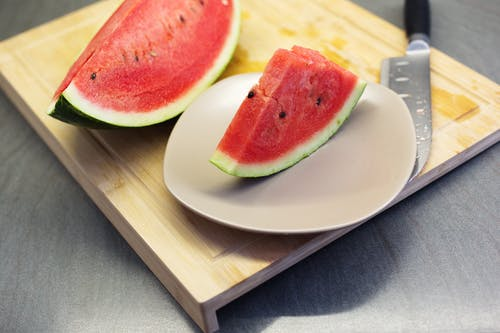 Served fresh watermelon slices on plate