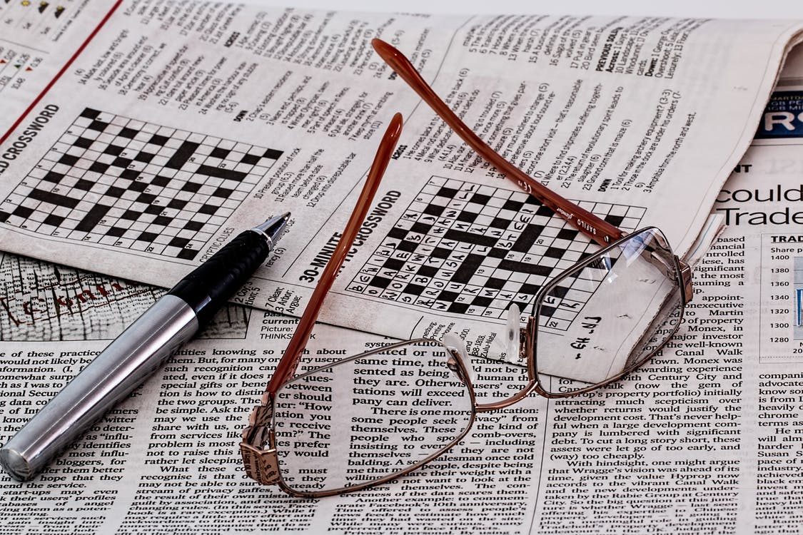 Frame Less Eyeglasses on Newspaper