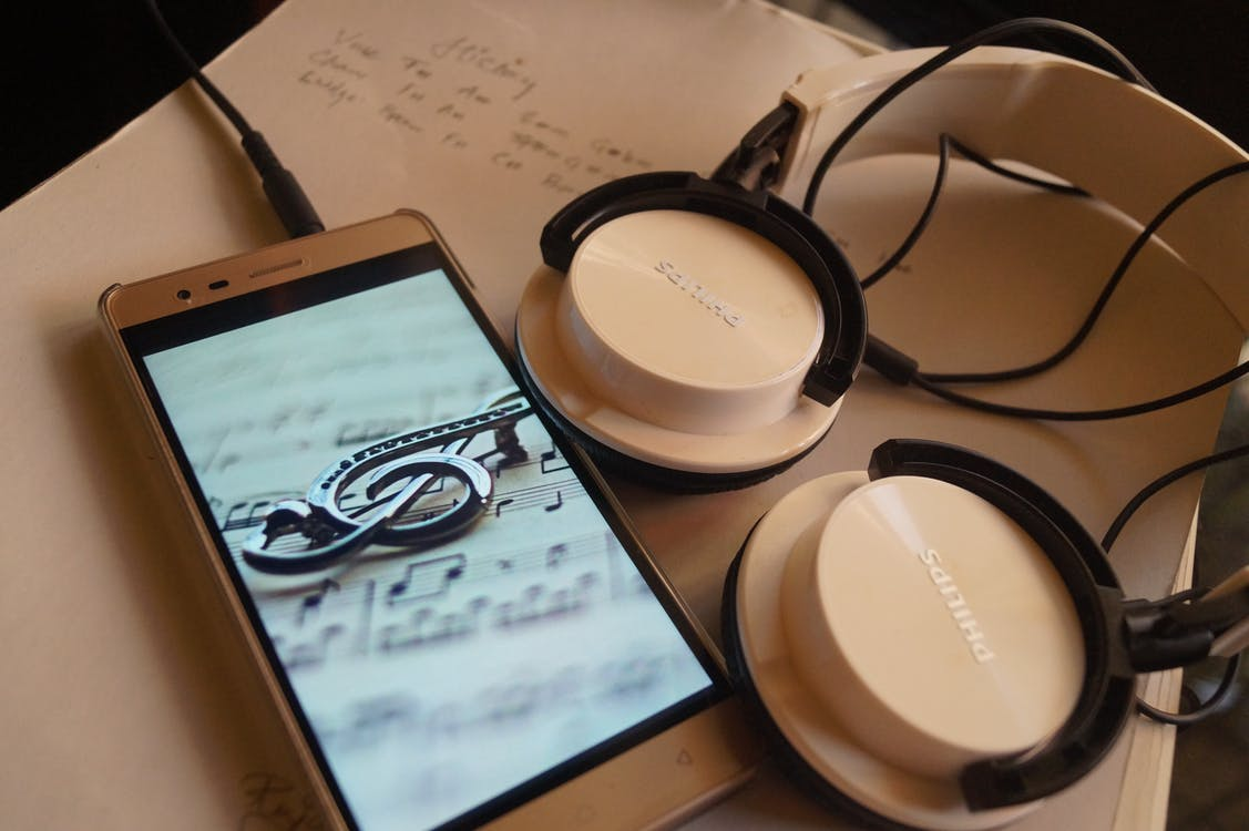 Silver Smartphone and Philips Headphones