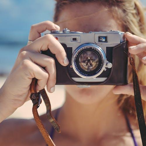 Camera In Girls Hand Free Stock Photo