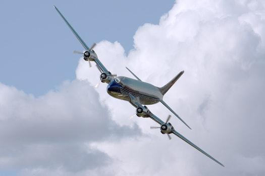 Chrome Airplane Flying during Daytime