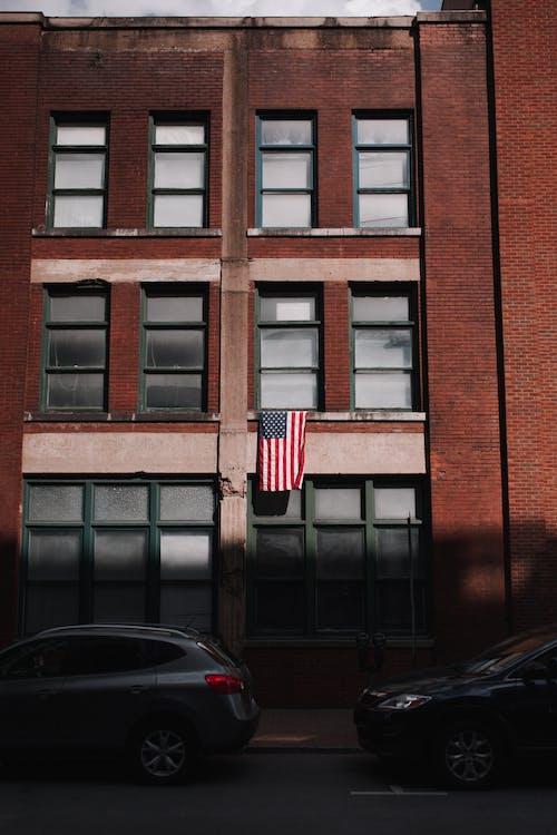 Black Car Parked Beside Red Building