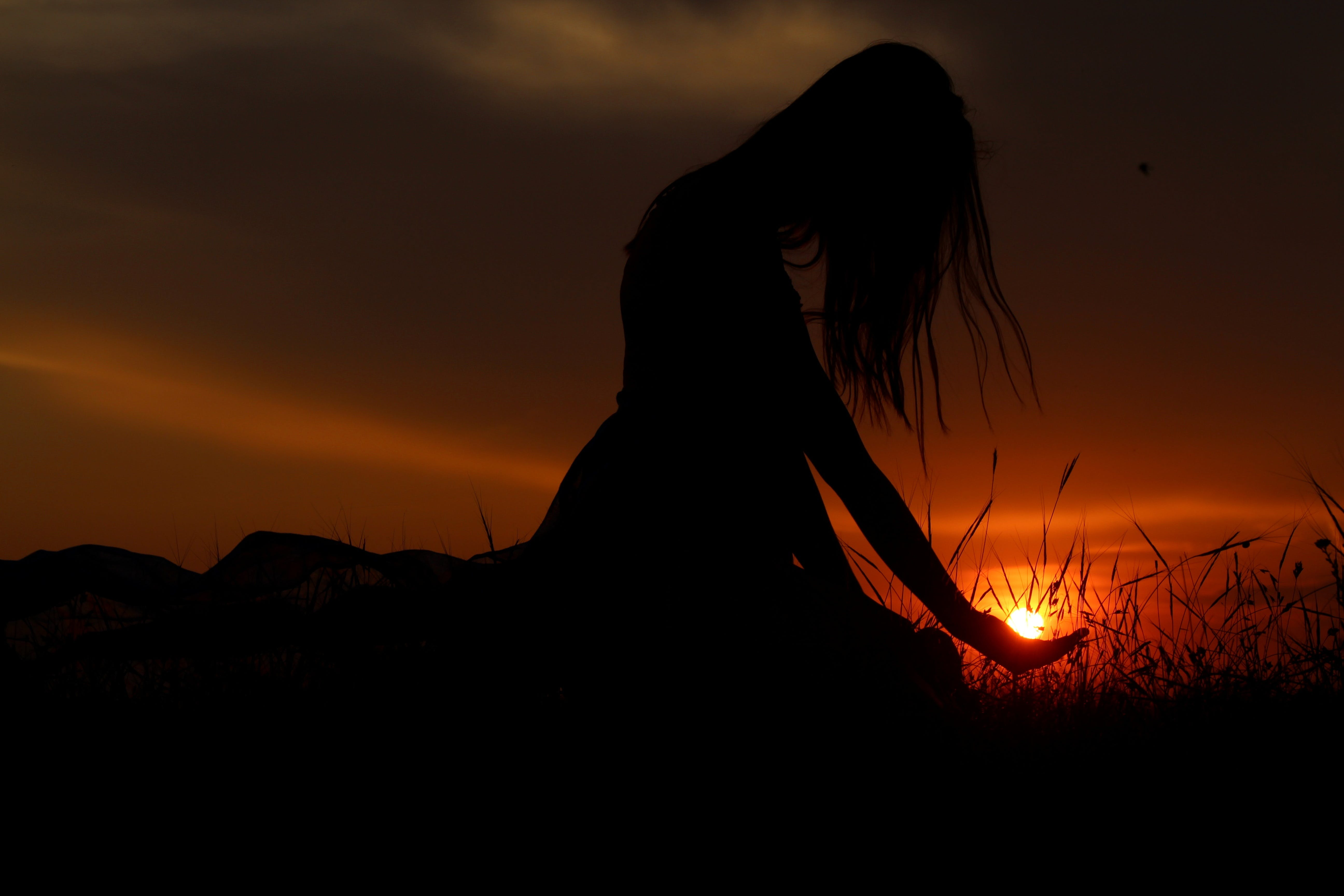 Woman's Silhouette during Golden Hour
