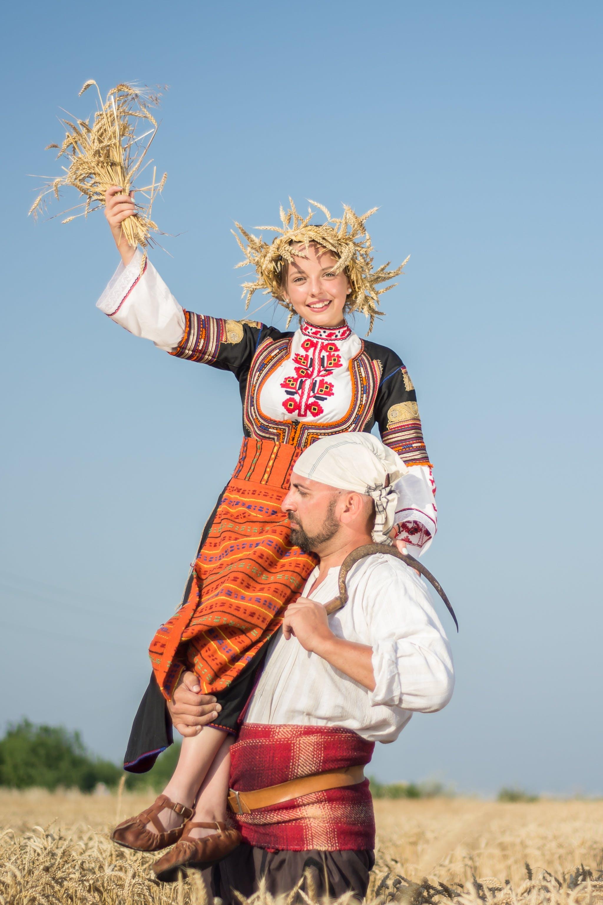 Man Raising Woman Through Shoulder
