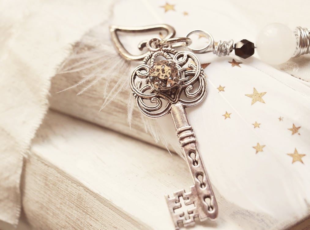 Silver Skeleton Key on White Surface